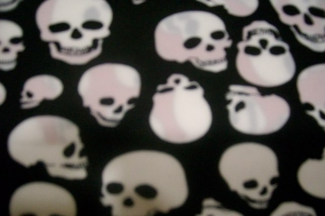 2. Black-White Black Eye Skull Print